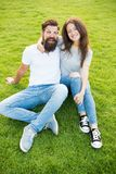Man bearded hipster and pretty woman in love. Summer vacation. Emotional couple radiating happiness. Love story. Couple. Relaxing green lawn. Happy together royalty free stock image