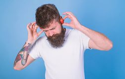 Man bearded hipster red ripe strawberry ears as headphones. Summer hit concept. Hipster beard listen music strawberry stock photography