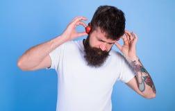 Man bearded hipster red ripe strawberry ears as headphones. Summer hit concept. Hipster beard listen music strawberry. Earphones. Guy enjoy juicy sound summer Stock Photos
