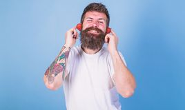Man bearded hipster red ripe strawberry ears as headphones. Summer top radio chart. Guy enjoy juicy sound summer hit stock image