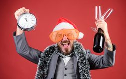 Man bearded hipster santa hold bottle. Corporate christmas party. Lets celebrate winter holiday. Boss santa hat. Celebrate new year or christmas. Christmas royalty free stock images