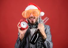 Man bearded hipster santa hold bottle. Corporate christmas party. Lets celebrate winter holiday. Boss santa hat. Celebrate new year or christmas. Join christmas stock images
