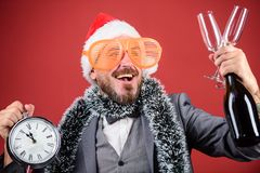 Man bearded hipster santa hold bottle. Corporate christmas party. Time celebrate winter holiday. Boss santa hat. Celebrate new year or christmas. Christmas stock photos