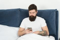 Man bearded hipster surfing internet social networks. Say hello to friends. Online communication. Mobile dependence. Social networks communication. Digital royalty free stock images
