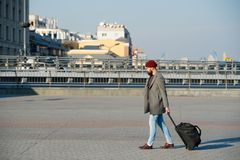 Man bearded hipster travel with big luggage bag on wheels. Let travel begin. Traveler with suitcase arrive to airport. Railway station. Hipster ready enjoy royalty free stock image