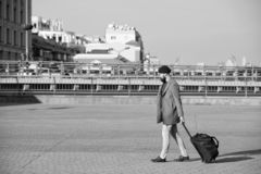 Man bearded hipster travel with big luggage bag on wheels. Let travel begin. Traveler with suitcase arrive to airport. Railway station. Hipster ready enjoy royalty free stock photos
