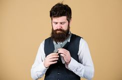 Man bearded hipster try to make knot. Different ways of tying necktie knots. Art of manliness. How to tie necktie. Start. With your collar up and the tie around royalty free stock photos