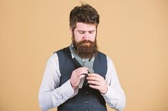 Man bearded hipster try to make knot. Different ways of tying necktie knots. Art of manliness. How to tie necktie. Start. With your collar up and the tie around stock photo
