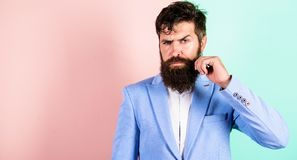 Man bearded hipster twisting mustache pink blue background. Ultimate moustache grooming guide. Expert tips for growing stock image