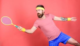 Man bearded hipster wear sport outfit. Tennis player beginner retro fashion. Concentrated on tennis court. Tennis sport. And entertainment. Athlete hipster hold royalty free stock photography