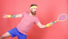 Man bearded hipster wear sport outfit. Tennis player beginner retro fashion. Concentrated on tennis court. Tennis sport. And entertainment. Athlete hipster hold stock photos