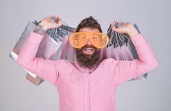 Man bearded hipster wear sunglasses while carry lot shopping bags. Shopping on black friday. Happy shopping with bunch stock photo