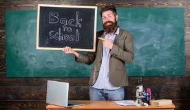 Man bearded holds blackboard inscription back to school. Hiring teachers for new school year. Looking committed teacher