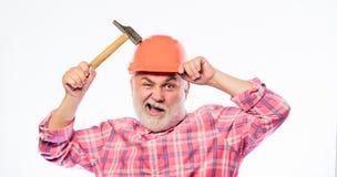 Man bearded laborer wear helmet hold hammer. Repair workshop. Repair concept. Senior foreman worker. Handyman home. Repair. Experienced engineer. Repairing or stock images