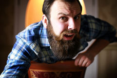 Man bearded look. Bearded handsome man sitting on a chair and posing for the camera Stock Photo