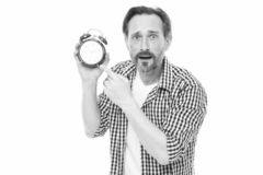 Man bearded mature guy hold alarm clock. Time management skill. Take control of time. Self discipline concept. How to. Avoid being late. Being late is habit stock image