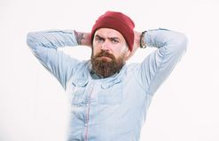 Man bearded with mustache brutal masculine appearance. Hipster style and fashion. Hipster bearded guy wear bright hat. Accessory. Bearded man posing confidently royalty free stock image
