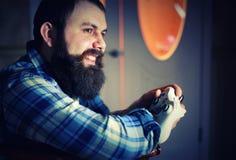 Man bearded play joystick stock images