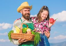Man bearded rustic farmer with kid. Father and daughter hold basket harvest vegetables. Gardening and harvesting. Family royalty free stock image