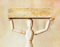 Man bearing heavy load over its head. Abstract image with a wood Stock Photo