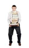 Man bears the big pile of books Royalty Free Stock Photography