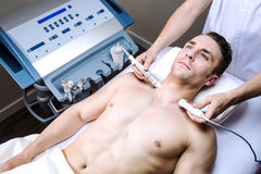 Man in a beauty clinic Stock Images