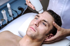 Man in a beauty clinic. Man in a clinic by becoming a beauty treatment Royalty Free Stock Photo