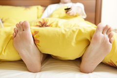 Man in bed Stock Images