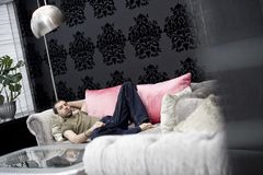 Man on a bed Royalty Free Stock Photos