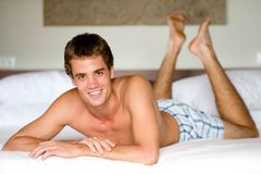 Man On Bed Stock Images