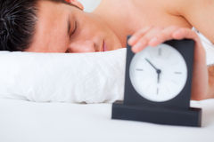 Man bed clock alarm royalty free stock images
