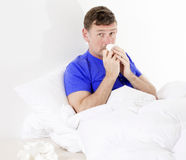Man in bed with a cold Royalty Free Stock Photos