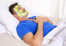 Man in bed with facial Stock Photography