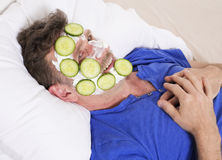 Man in bed with facial Royalty Free Stock Photography