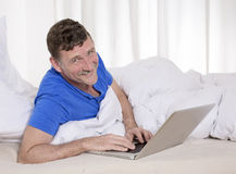 Man in bed with laptop Royalty Free Stock Image
