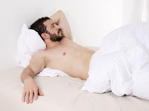 Man in bed Royalty Free Stock Photography