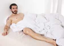 Man in bed Royalty Free Stock Photos
