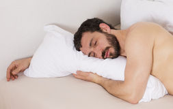 Man in bed and sleeping Royalty Free Stock Images