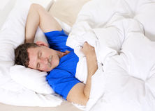 Man in bed sleeping Royalty Free Stock Photo