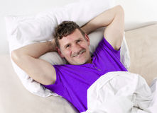 Man in bed smiling Royalty Free Stock Photography