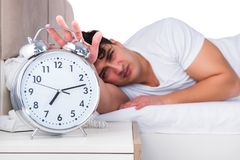The man in bed suffering from insomnia Stock Image