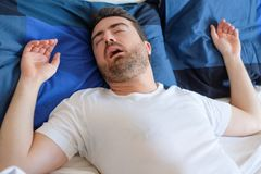 Face close up of snoring man because of hypopnea disorder Royalty Free Stock Image