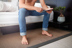 Man on the bed using tablet pc Royalty Free Stock Image