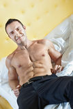 Man in bed Stock Photography