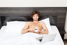 Man on bed Royalty Free Stock Photos