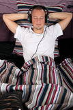 Man bedroom headset Stock Image