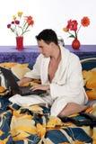 Man bedroom laptop Stock Images