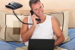 Man bedroom laptop Stock Photo