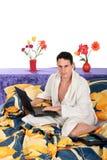 Man bedroom laptop Stock Photography