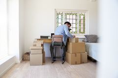 Man In Bedroom Running Business From Home Labeling Goods Stock Photos